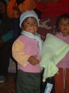 one of the children with the blankets
