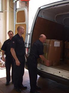 Leyland Fire officers unloading the boxes