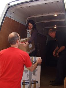 Maria and the fire officers in Leyland unloading